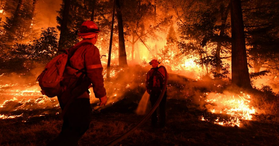 Firefighters try to control a back burn near Redding, California, on July 31.