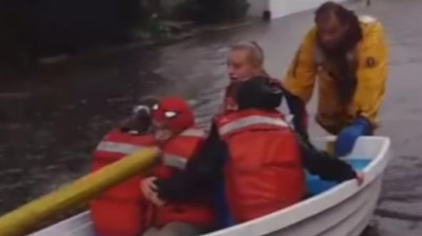 First responders in Stamford, Connecticut rescue children whose school bus stalled on a flooded street.