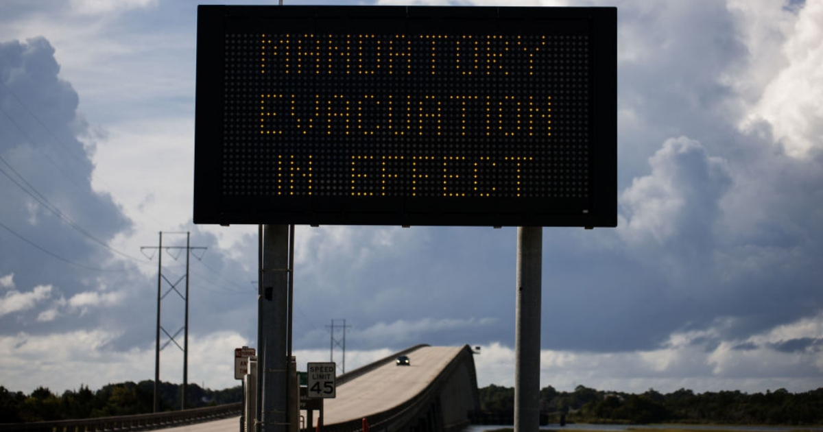 A sign stating 'Mandatory Evacuation in Effect' can be seen at the bridge over the intercoastal waterway in Cedar Point, North Carolina on Wednesday in advance of Hurricane Florence.