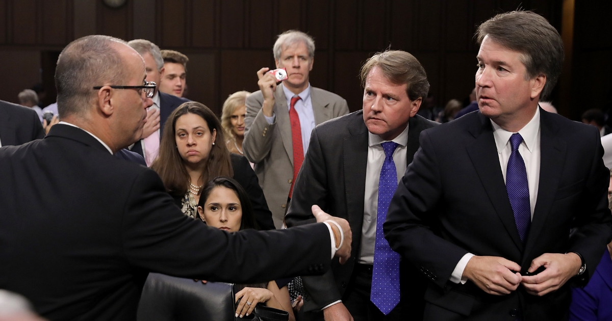Fred Guttenberg, left, tries to shake Supreme Court nominee Judge Brett Kavanaugh's hand