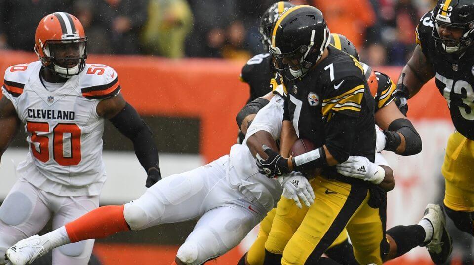 Myles Garrett of the Cleveland Browns sacks Ben Roethlisberger of the Pittsburgh Steelers on Sunday at Cleveland's FirstEnergy Stadium.