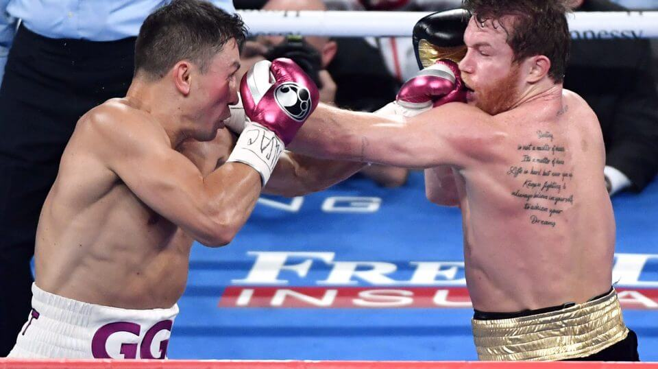Gennady Golovkin, left, and Canelo Alvarez battle in the second round of their WBC/WBA middleweight title fight Saturday in Las Vegas, Nevada. Alvarez won by majority decision.