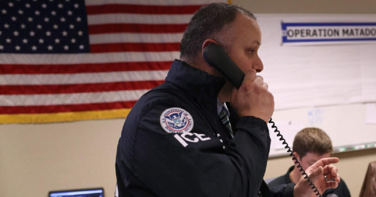 An Immigration and Customs Enforcement agent is pictured during a March illegal immigration crackdown in Central Islip, New York.