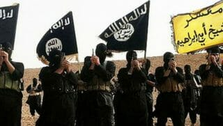 Masked ISIS fighters flying the ISIS flag.