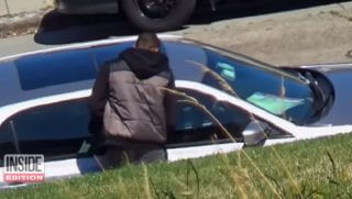"A car burglar prepares to break into a ""bait"" car left by ""Inside Edition"" on a San Francisco street to catch thieves. T"
