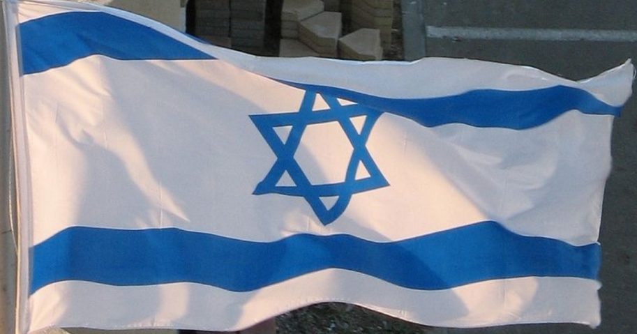 The Israeli flag flies outside a hotel in Netanya, Israel.