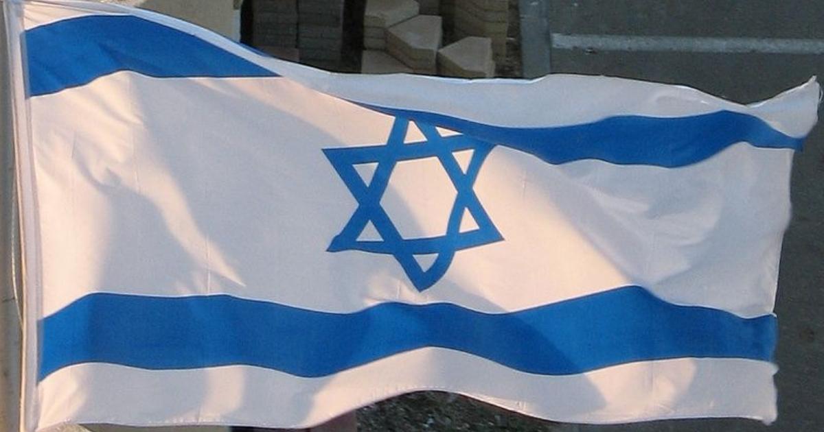 The Israeli flag flies outside a hotel in Netanya, Israel.