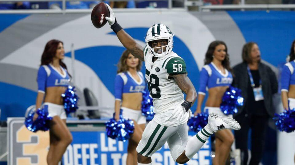 Darron Lee of the New York Jets intercepts a pass from Lions quarterback Matthew Stafford and runs it in for a touchdown in the second half Monday night at Detroit's Ford Field.