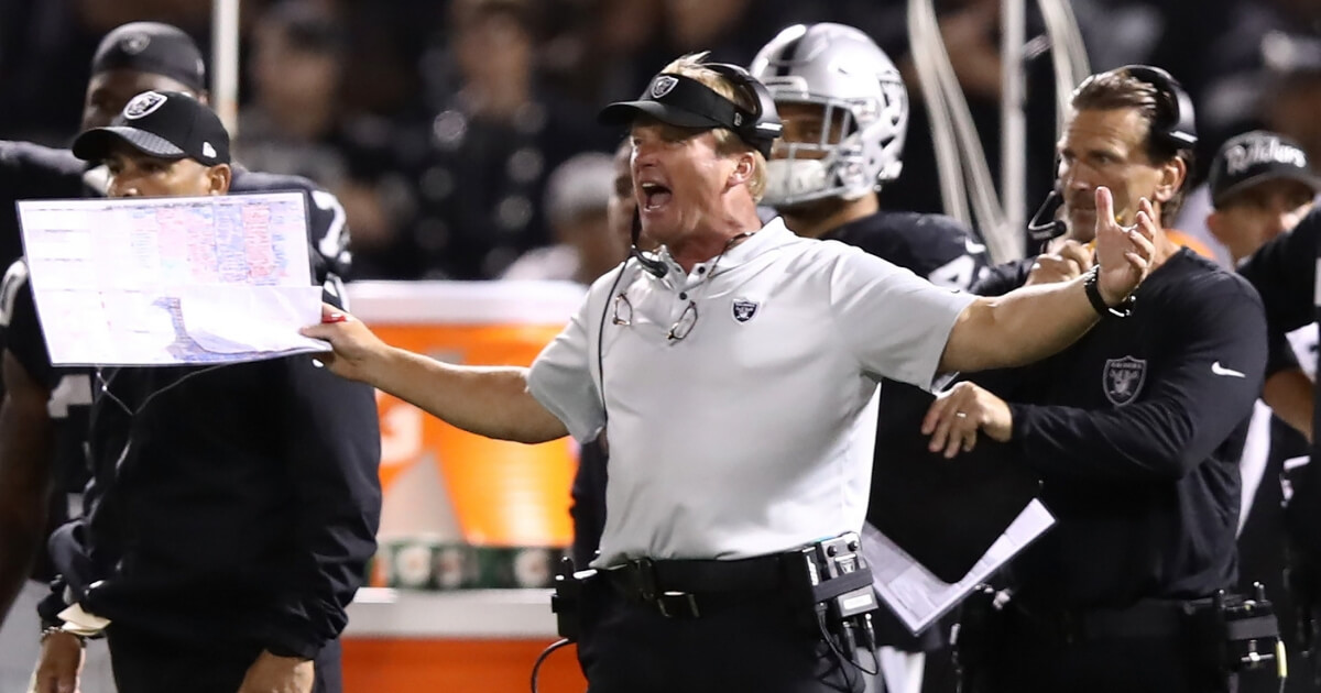 Oakland head coach Jon Gruden reacts to a play in the Raiders' season opener Monday night against the Los Angeles Rams at Oakland-Alameda County Coliseum.