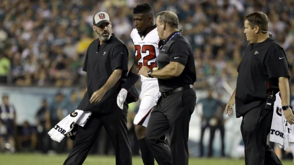 Atlanta Falcons' Keanu Neal is helped off the field after an injury during the first half against the Philadelphia Eagles on Thursday night.
