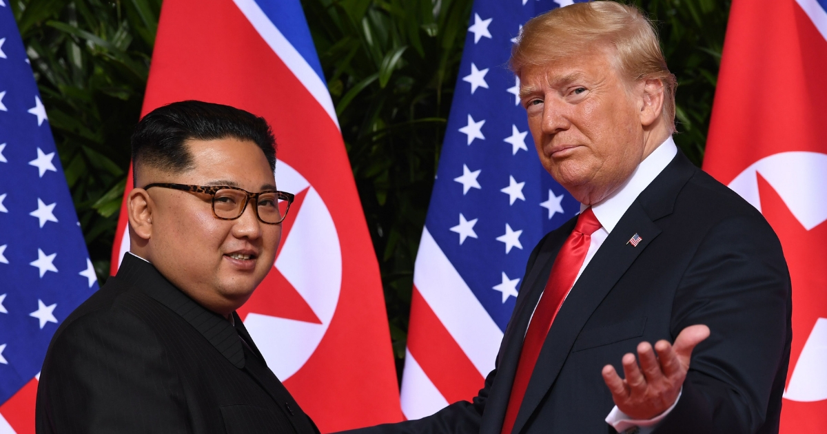 President Donald Trump, right, meets with North Korea's leader Kim Jong Un, left, at the start of their historic summit.