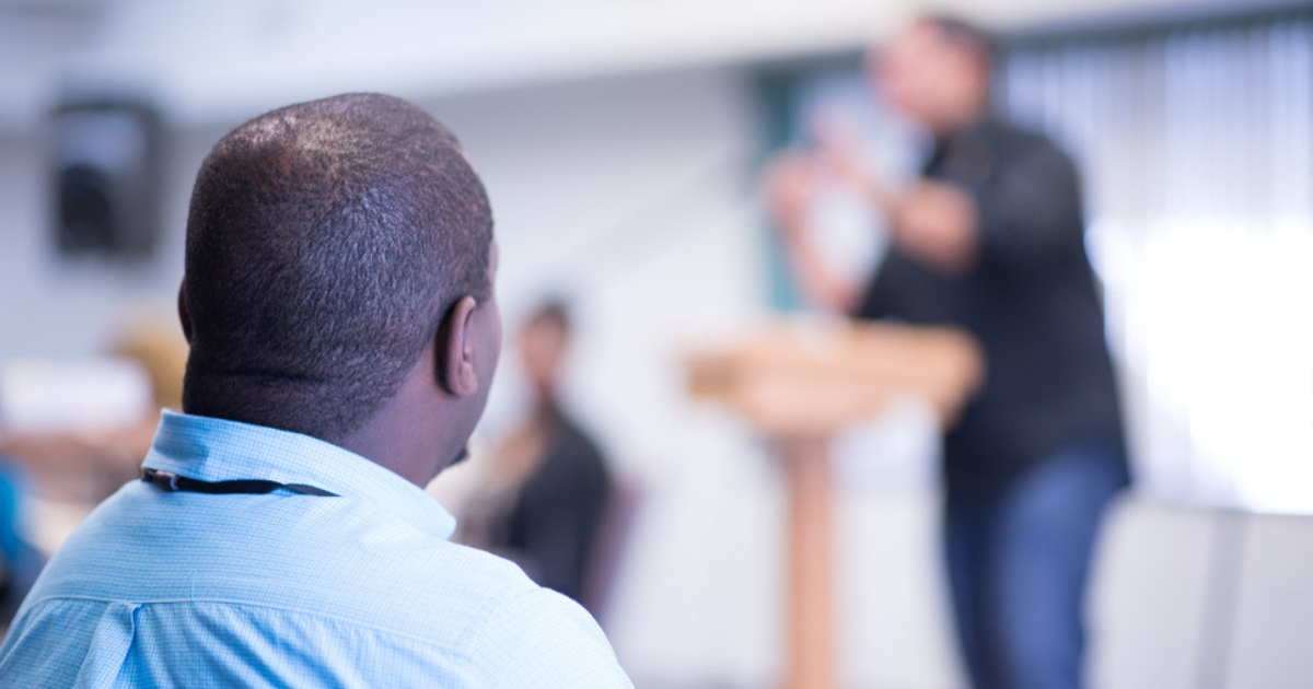 Man Listens to Sermon