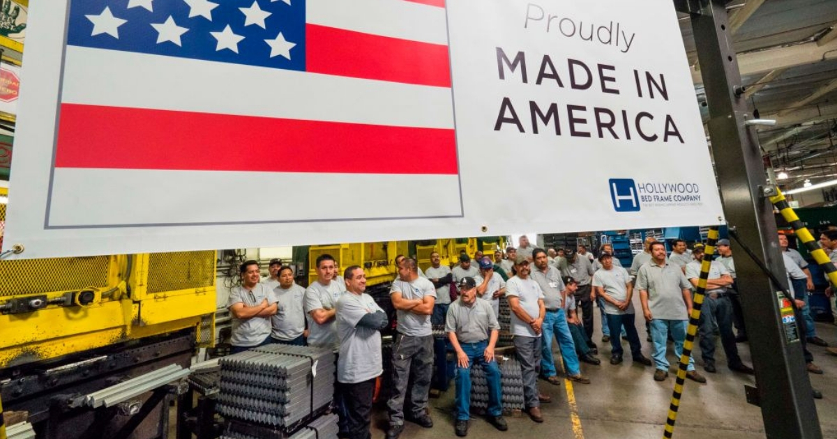 Workers at the Hollywood Bed Frame Company mark the company's expansion which doubled the manufacturer's workforce, adding 100 new local jobs, at the company's factory in Commerce, California.