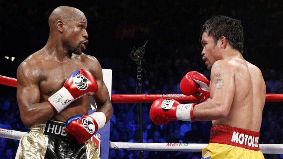 Floyd Mayweather Jr. exchange punches with Manny Pacquiao during their welterweight unification championship bout May 2, 2015, at MGM Grand Garden Arena in Las Vegas. Mayweather defeated Pacquiao by unanimous decision.