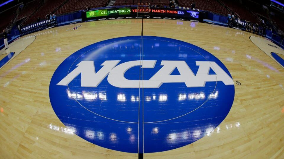 The NCAA logo is shown before a second-round game of the 2013 NCAA college basketball tournament in Philadelphia.