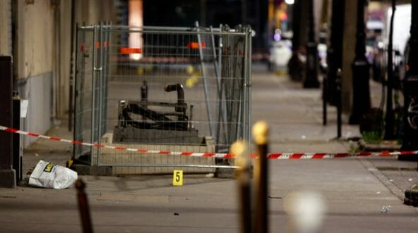 Evidence is seen at the site of a knife attack in Paris, Monday, Sept. 10, 2018. Several people were injured but police said terrorism was not suspected.