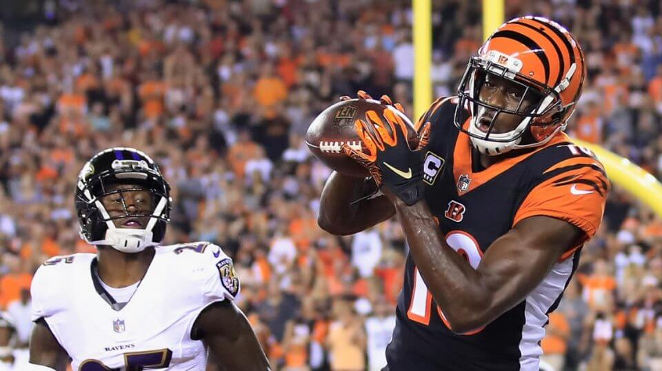 A.J. Green of the Cincinnati Bengals scores a touchdown against Tavon Young of the Baltimore Ravens in the first quarter Thursday night at Paul Brown Stadium in Cincinnati, Ohio.