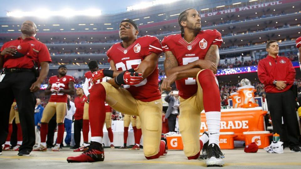 Eric Reid, left, and Colin Kaepernick of the San Francisco 49ers kneel during the national anthem prior to a game against the Los Angeles Rams at Levi Stadium on Sept. 12, 2016.