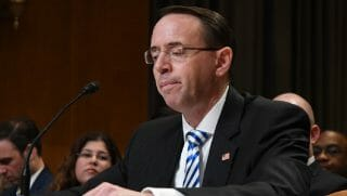 Rod Rosenstein grimacing at a table.