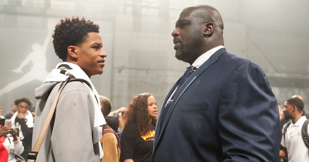Shareef O'Neal, left, talks to his father, Shaquille O'Neal, at the Jordan Brand Future of Flight Showcase on Jan. 25 in Studio City, California.