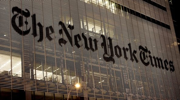 The New York Times headquarters at night.