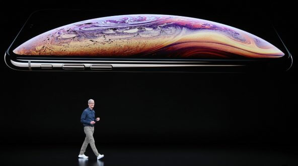 Tim Cook, chief executive officer of Apple, announces new iPhone models Wednesday at Apple headquarters in Cupertino, California.