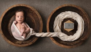 Twin Boy Swaddled Next to Ashes