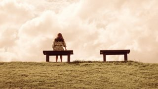 Woman waiting on bench