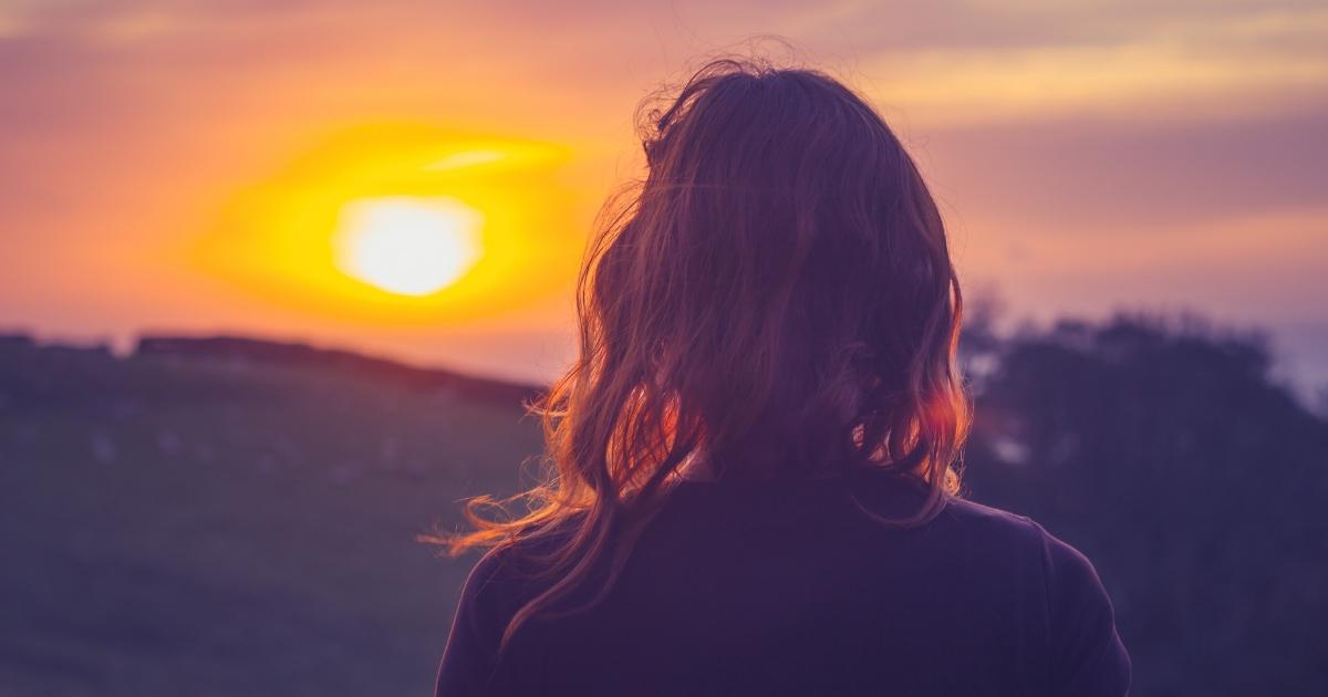 Woman at sunset.