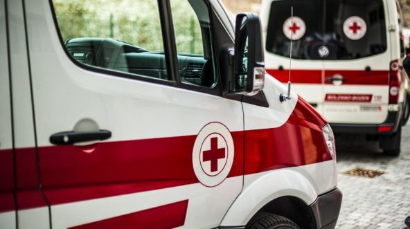 Red and white ambulances.