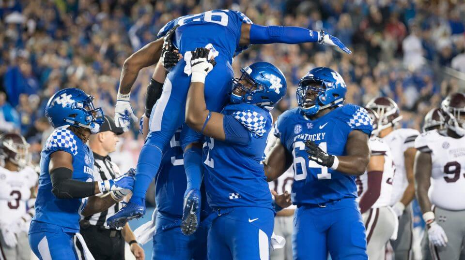 Kentucky running back Benny Snell Jr. (26) is hoisted in celebration following his touchdown during the Wildcats' win over Mississippi State on Saturday.