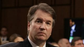 Supreme Court nominee Brett Kavanaugh listens to a question during his confirmation hearing.