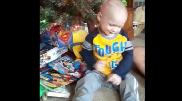 Brody Allen enjoys listening to Christmas music played especially for him by a Cincinnati radio station.