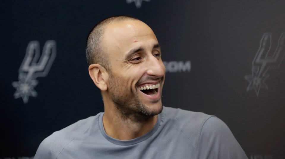 Former San Antonio Spurs guard Manu Ginobili jokes with the media at the NBA basketball team's practice facility Saturday.