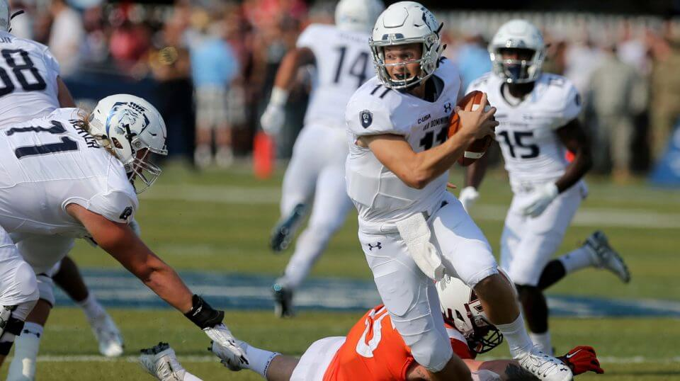 Old Dominion quarterback Blake LaRussa avoids a sack by Virginia Tech's Jerrod Hewitt during ODU's upset win in Norfolk, Virginia.