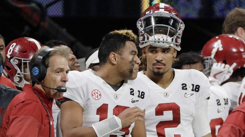 Alabama quarterbacks Jalen Hurts (2) and Tua Tagovailoa (13) and head coach Nick Saban watch from the sideline during the NCAA college football playoff championship game against Georgia in January.