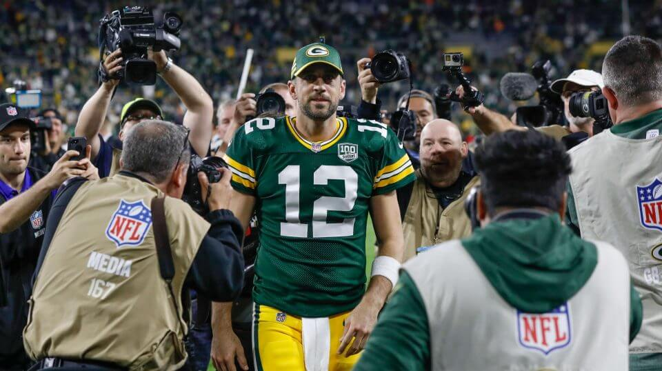 Green Bay Packers quarterback Aaron Rodgers walks off the field after leading his team to a 24-23 comeback victory at Lambeau Field