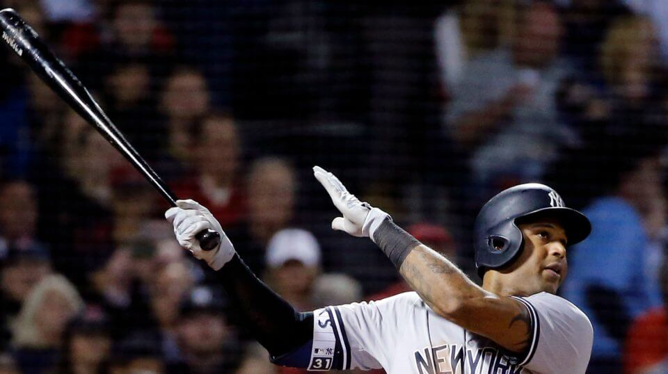 New York Yankees' Aaron Hicks hits a three-run home run against the Boston Red Sox in the fourth inning Friday at Fenway Park.