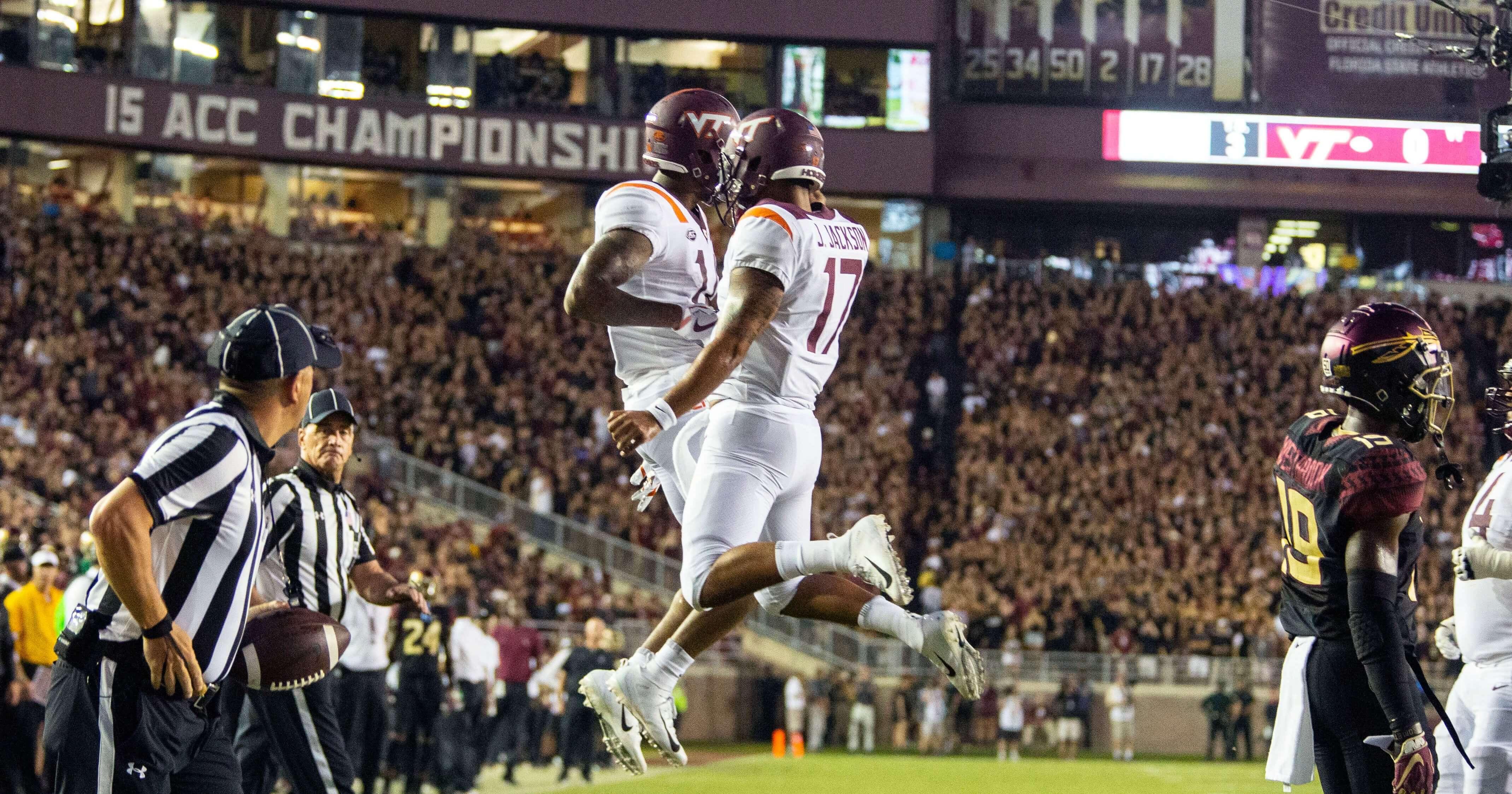 Virginia Tech Hokies wide receiver Damon Hazelton, left, and quarterback quarterback Josh Jackson celebrate a touchdown on their first drive against Florida State on Monday night in Tallahassee.
