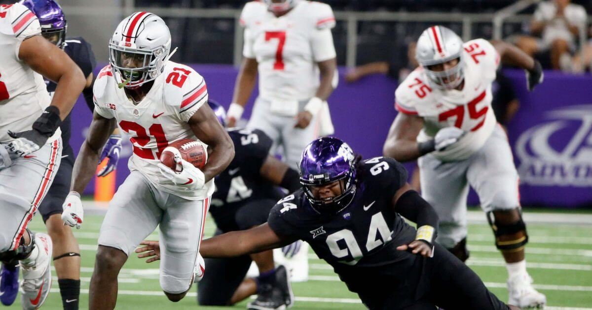 Ohio State wide receiver Parris Campbell (21) runs for a touchdown against TCU Saturday in Arlington, Texas.