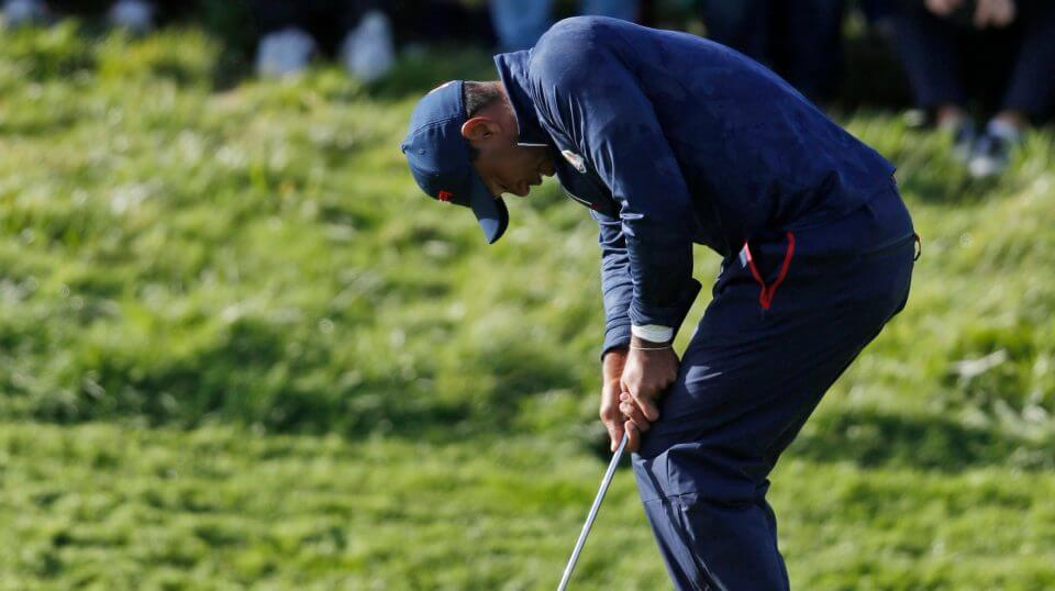 Tiger Woods reacts after missing a putt Saturday on the eighth green during a fourball match on the second day of the 42nd Ryder Cup at Le Golf National in Saint-Quentin-en-Yvelines, outside Paris.