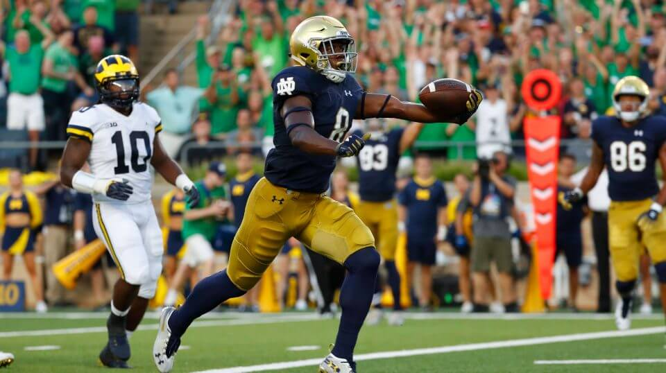Notre Dame wide receiver Jafar Armstrong (8) scores a touchdown in front of Michigan linebacker Devin Bush (10) in the first half of an NCAA football game in South Bend, Ind., Saturday.