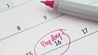 A date on a calendar is circled and designated as 'Pay Day'