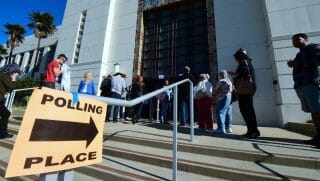 People wait in line to vote in the US presidential election at Santa Monica City Hall
