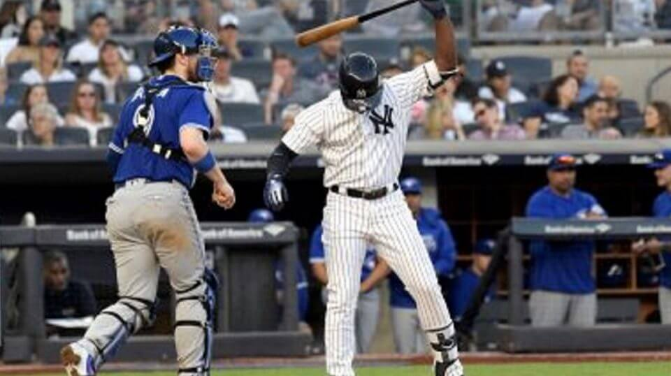 New York Yankees Andrew McCutchen reacts after striking out to end the seventh inning of a baseball game as Toronto Blue Jays catcher Danny Jansen, left, heads off the field at on Sept. 15 Yankee Stadium in New York.