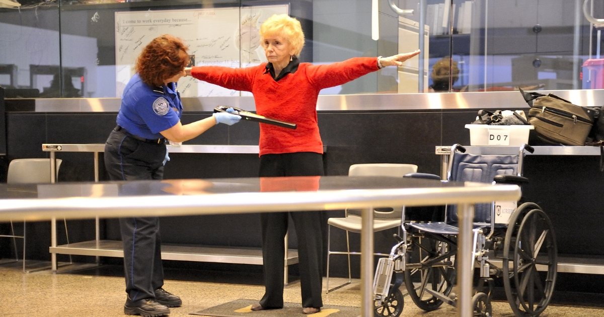 TSA agent scans a passenger