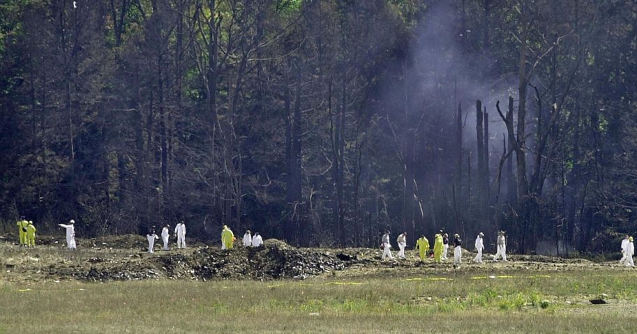 Investigative personnel search the crash site of United Airlines Flight 93