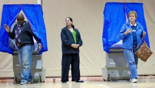 Voters leaving voting booths