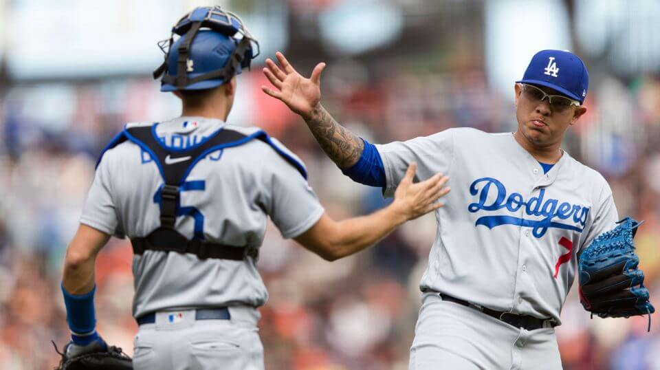 Los Angeles Dodgers catcher Austin Barnes, left, and relief pitcher Julio Urias celebrate after defeating the San Francisco Giants on Sunday.