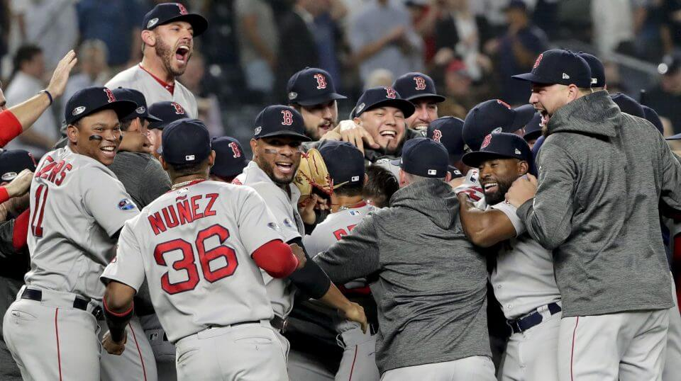 The Boston Red Sox celebrate after beating the New York Yankees 4-3 in Game 4 of the American League Division Series on Tuesday in New York.